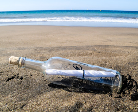 Message in a bottle on a lonely beach ,in Tenerife, Spain