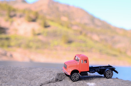dumptruck: Transportation Concept Old Toy Truck on the Rocks