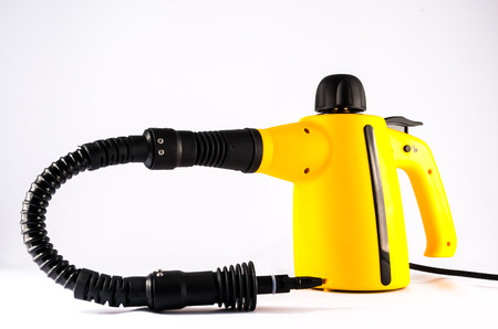 Picture of Yellow Hot Vapor Cleaning Machine Stock Photo