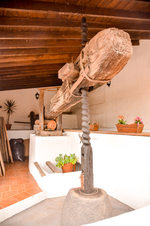 old spanish wooden winepress for pressing grapes to produce wine