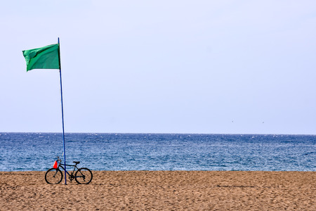 Spanish View Landscape in Tropical Volcanic Canary Islands Spain with bike and flag
