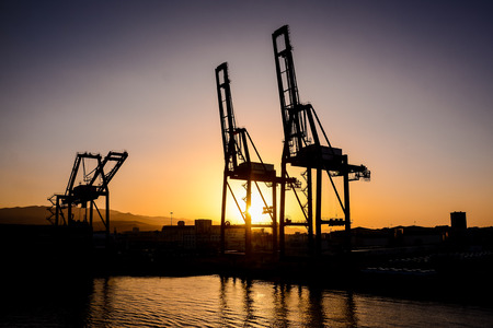 gran canaria: Silhouette of an offshore drilling rig and supply vessel at sunset