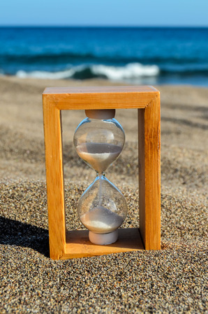 turistic: Photo Picture of Hourglass Clock on the Sand Beach Stock Photo