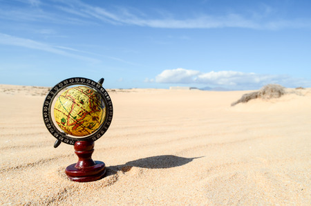 Conceptual Photo Picture of a Globe Earth Object in the Dry Desert Stock Photo