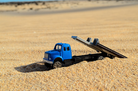 Conceptual Photo Picture of a toy car in the dry desert Stock Photo