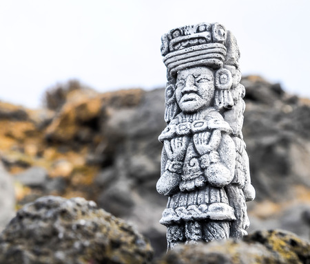 Ancient Maya Statue on the Rocks near the Ocean Banco de Imagens - 81836203