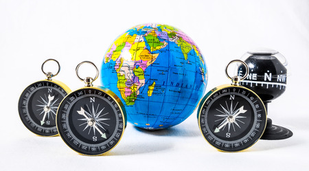 Orientation Concept Earth and Compass on a White Background