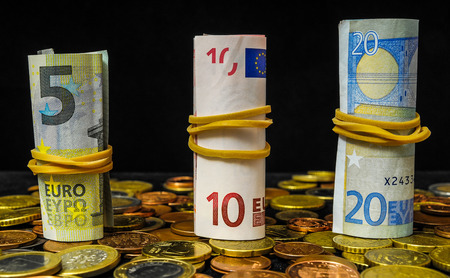 one hundred euro banknote: Some Scattered Money Representing Different Markets Financial Concept Stock Photo