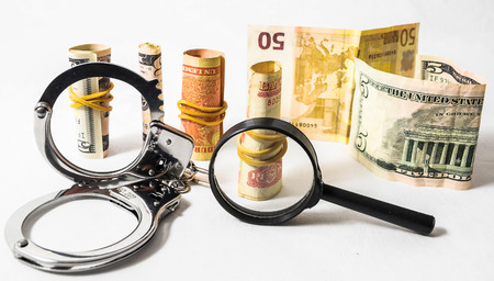 Tax Crime Concept Money and Handcuffs on a White Background Zdjęcie Seryjne