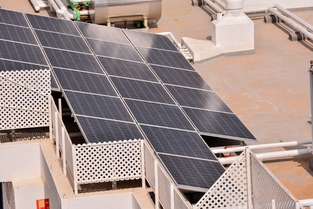 aerial view of solar panels pv cells on a factory roof in spain Stock Photo
