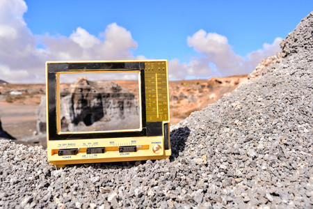 Conceptual Photo Picture of a Television Object in the Dry Desert