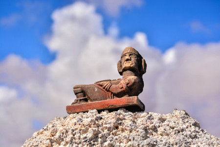 Conceptual Photo Picture of a Mayan Statue in the dry desert Stock Photo