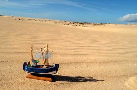 Conceptual Photo Picture of a Boat Object in the Dry Desert