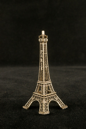 Eiffel Tower toy miniature on black background Banque d'images