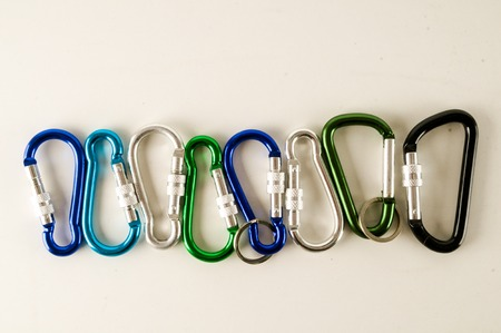 Metal aluminum snap hook isolated background Safety lock carabiner for rope climbing