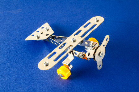Photo picture of a Small toy metal plane airplane Stock Photo