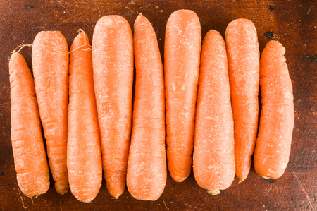 Photo picture Close up of fresh carrots background texture