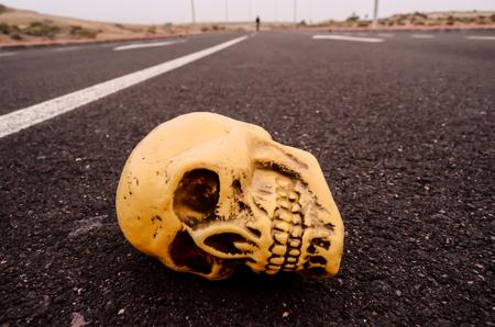 Road Death Concept Skull on the Asphalt Street Stock Photo