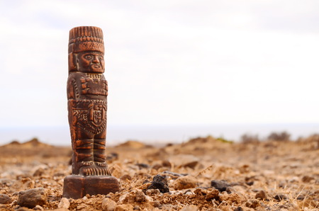 Ancient Maya Statue on the Rocks Desert