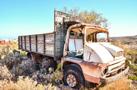 Rusty Abandoned Truck on the Desert, in Canary Islands, Spain Stock Photo