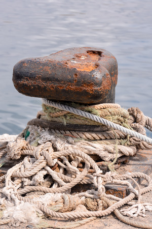 Photo picture of a Rusty metal mooring bolard for big ship