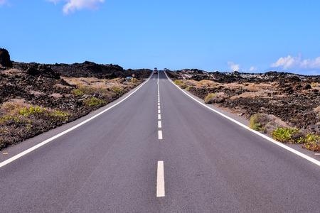 Long Empty Desert Asphalt Road in Canary Islands Spain 写真素材