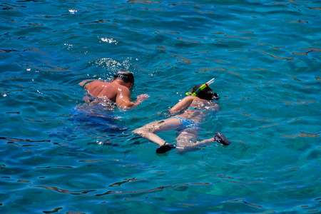 People Enjoying snorkelling with clear cold blue water