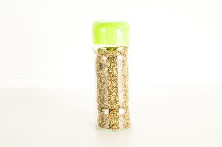Bottle of dried oregano leaves isolated on white background Archivio Fotografico - 101233196