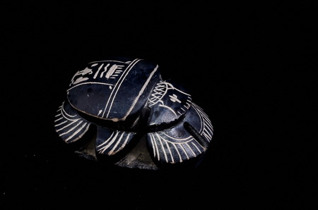 Stone Ritual Egyptian Scarab isolated on Black Background