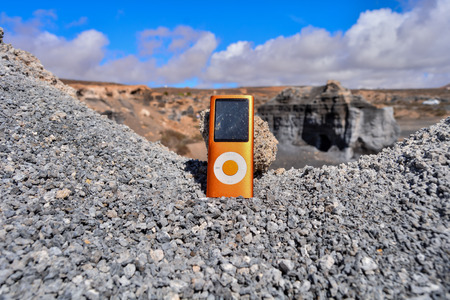 Conceptual Photo Picture of a Music Player Object in the Dry Desert