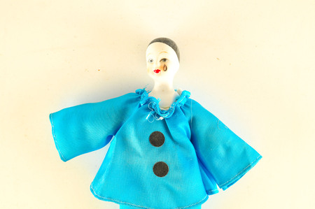 Photo of Pierrot toy doll on white background