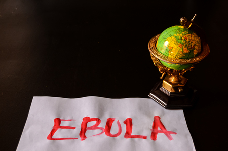Word Ebola Text Writed with Blood on a White Paper
