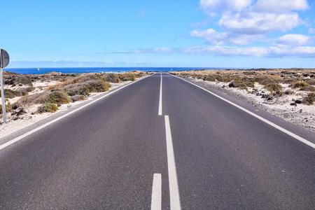 Long Empty Desert Asphalt Road in Canary Islands Spain Stok Fotoğraf