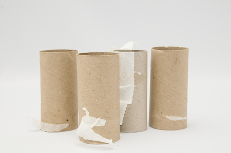 Empty Toilet Rolls Stack Up On a Black Background Imagens