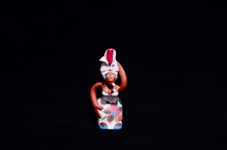 Clay Handmade Statue of a Cuban Woman on Black Background Archivio Fotografico