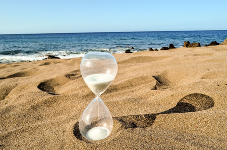 Photo Picture of Hourglass Clock on the Sand Beach Stok Fotoğraf - 109114927