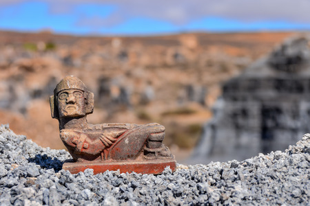 Conceptual Photo Picture of a Mayan Statue in the dry desert