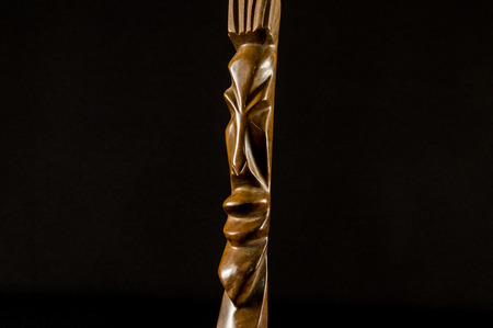 Close up of African traditional wooden Statue figurine Archivio Fotografico - 117906217