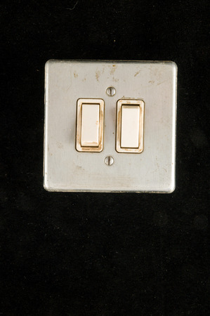Close-up of elctric switch interruptor Object on a black Background