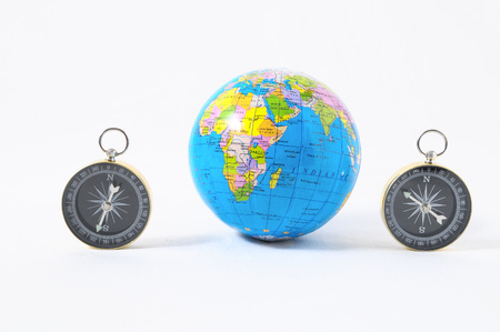 Orientation Concept Earth and Compass on a White Background Stock Photo - 112072191