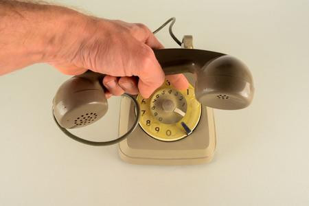 Old vintage analogic telephone in white background 版權商用圖片