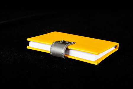Close-up of note book Object on a Black Background 版權商用圖片