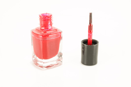 red nail polish bottle on white background 写真素材