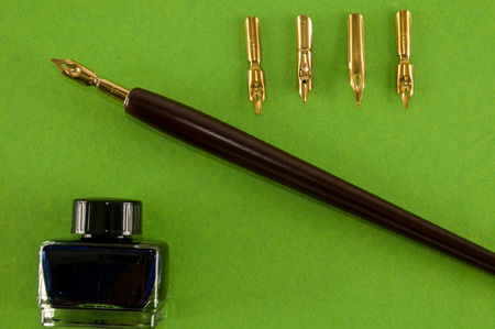 Photo picture of an antique ink fountain pen background 写真素材