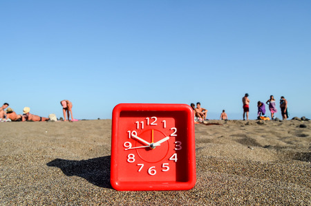 Photo Picture of a Clock on the Sand Beach