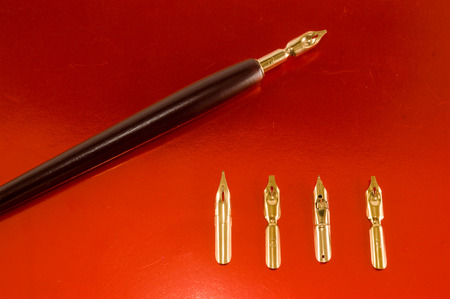 Photo picture of an antique ink fountain pen background Stockfoto - 116156144