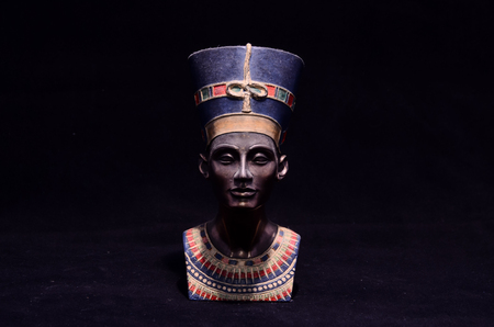 Famous Statuette Bust of Queen Nefertiti Isolated on Black Background