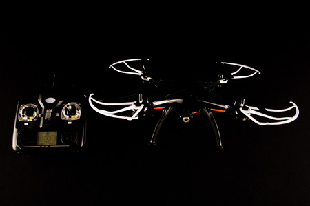 Technology Copter closeup Aircraft Drone Quadrocopter with a raised chassis Stock Photo