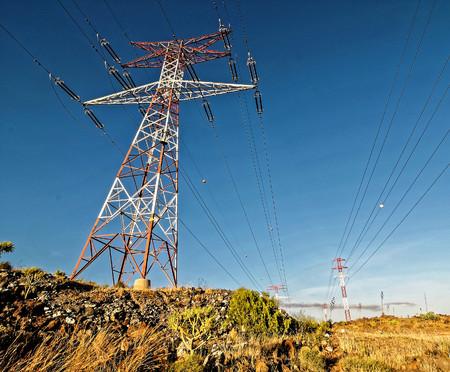 Energy Electricity Power Pylon on a Blue Sky