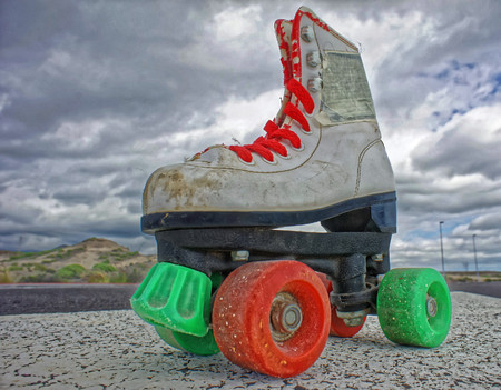 Hdr Picture of Old Vintage White Skate Boot on the Asphalt Sterret